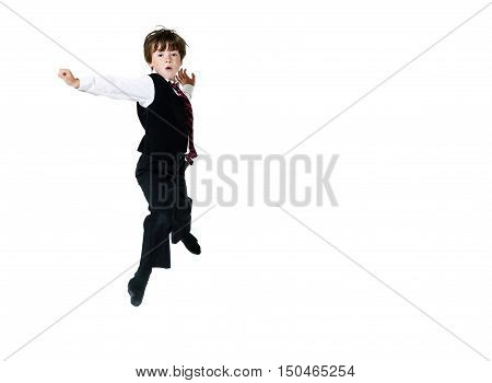 Expressive Red-haired Freckled Boy Shooting In The Fly While Jumping