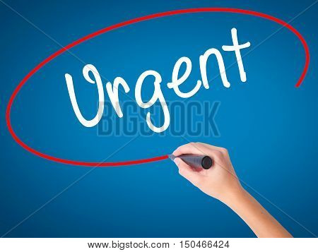 Women Hand Writing Urgent With Black Marker On Visual Screen.