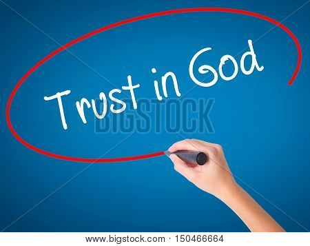 Women Hand Writing Trust In God With Black Marker On Visual Screen