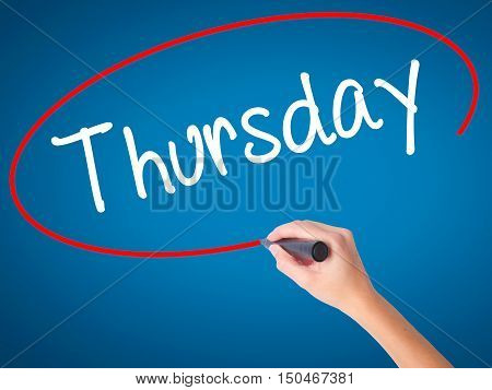 Women Hand Writing Thursday With Black Marker On Visual Screen