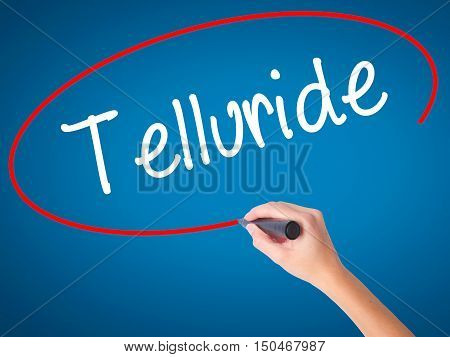 Women Hand Writing Telluride With Black Marker On Visual Screen
