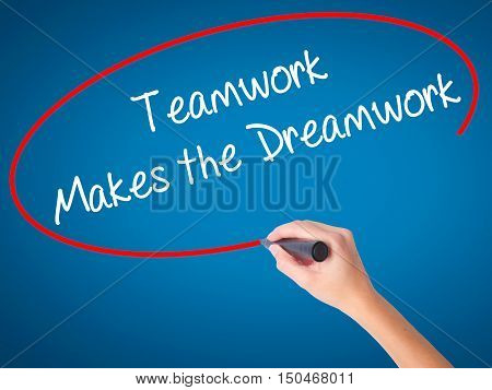 Women Hand Writing Teamwork Makes The Dreamwork With Black Marker On Visual Screen