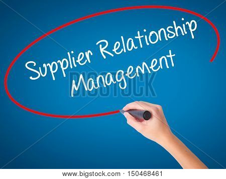 Women Hand Writing Supplier Relationship Management With Black Marker On Visual Screen.