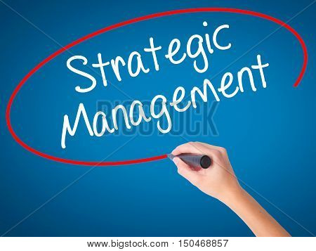 Women Hand Writing Strategic Management With Black Marker On Visual Screen.