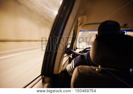 View From The Car Window, Car Moving Through The Tunnel At Light. Driver Driving Car
