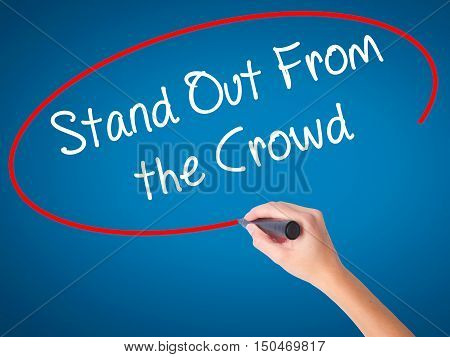 Women Hand Writing Stand Out From The Crowd With Black Marker On Visual Screen