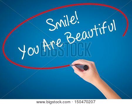 Women Hand Writing Smile! You Are Beautiful With Black Marker On Visual Screen