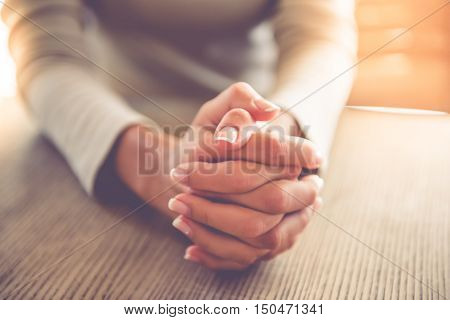 Cropped image of beautiful business lady clasping hands together