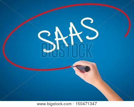 Women Hand Writing Saas With Black Marker On Visual Screen
