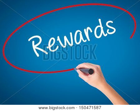 Women Hand Writing Rewards With Black Marker On Visual Screen