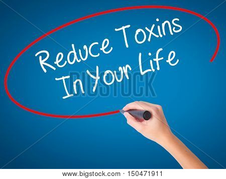 Women Hand Writing Reduce Toxins In Your Life With Black Marker On Visual Screen