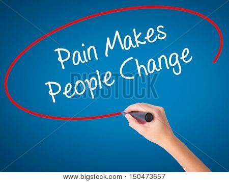 Women Hand Writing Pain Makes People Change  With Black Marker On Visual Screen