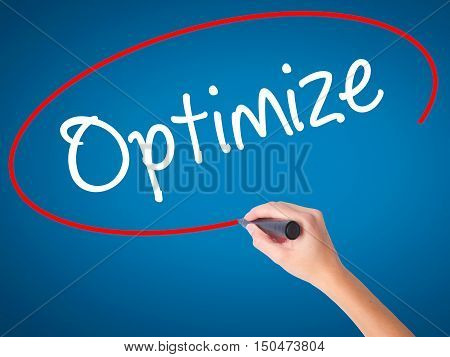 Women Hand Writing Optimize With Black Marker On Visual Screen