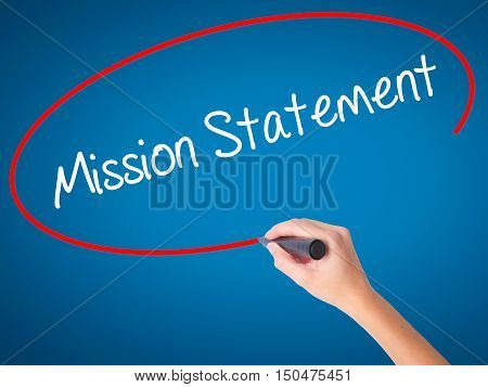 Women Hand Writing Mission Statement With Black Marker On Visual Screen