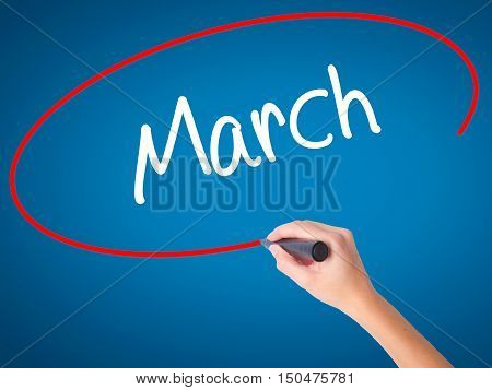 Women Hand Writing March With Black Marker On Visual Screen