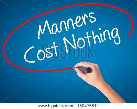 Women Hand Writing Manners Cost Nothing With Black Marker On Visual Screen
