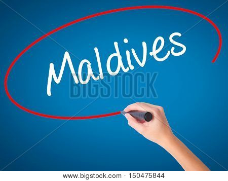 Women Hand Writing Maldives  With Black Marker On Visual Screen