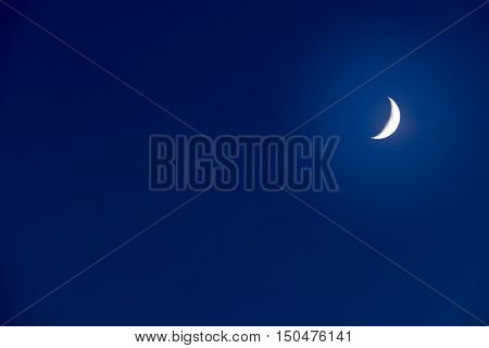 Moon on a dark blue sky. Copy Space for your text.