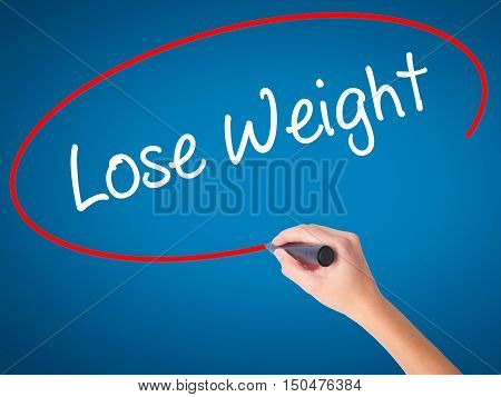 Women Hand Writing Lose Weight With Black Marker On Visual Screen