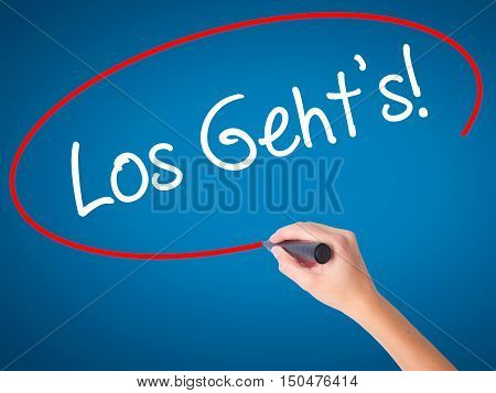 Women Hand Writing Los Geht's! (here We Go In German) With Black Marker On Visual Screen