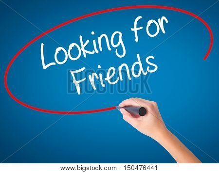 Women Hand Writing Looking For Friends With Black Marker On Visual Screen.