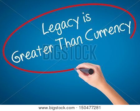 Women Hand Writing Legacy Is Greater Than Currency With Black Marker On Visual Screen