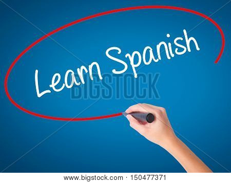 Women Hand Writing Learn Spanish With Black Marker On Visual Screen