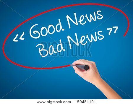 Women Hand Writing Good News - Bad News With Black Marker On Visual Screen.