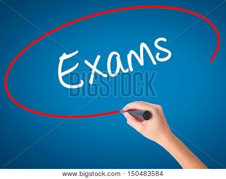 Women Hand Writing Exams With Black Marker On Visual Screen