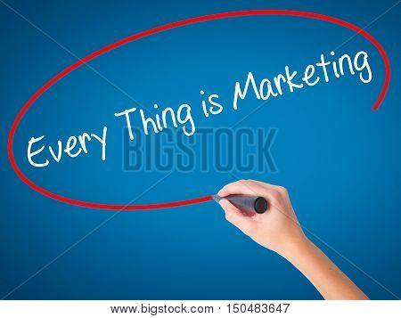 Women Hand Writing  Every Thing Is Marketing With Black Marker On Visual Screen