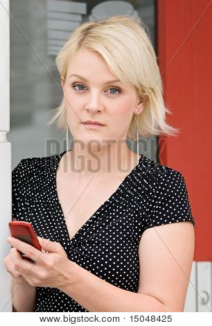 Serious Blond with Phone