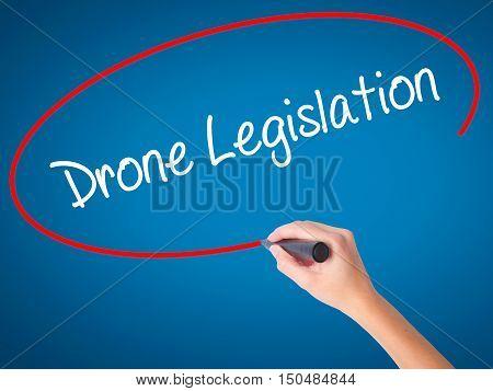 Women Hand Writing Drone Legislation With Black Marker On Visual Screen