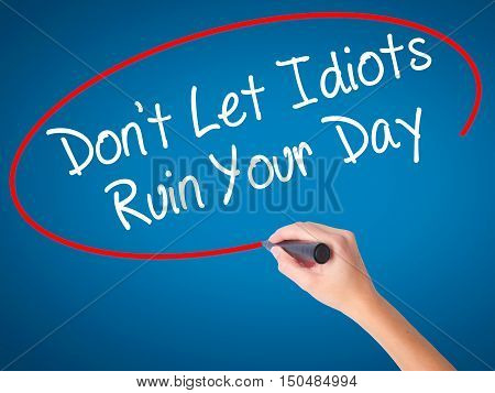 Women Hand Writing Don't Let Idiots Ruin Your Day With Black Marker On Visual Screen