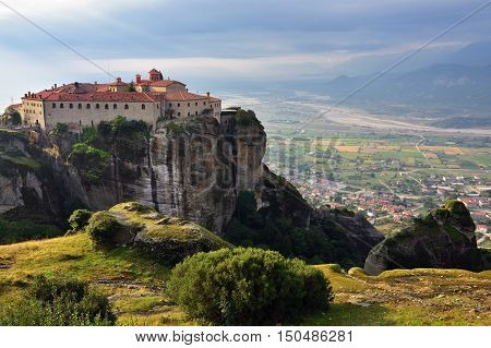 Meteora monasteries. Beautiful view on the Holy Monastery of Saint Stephen placed on the edge of high rock covered of the morning at sun rises Kastraki Greece