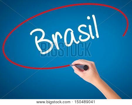 Women Hand Writing Brasil ( Brazil  In Portuguese) With Black Marker On Visual Screen
