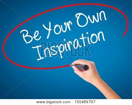 Women Hand Writing Be Your Own Inspiration With Black Marker On Visual Screen.