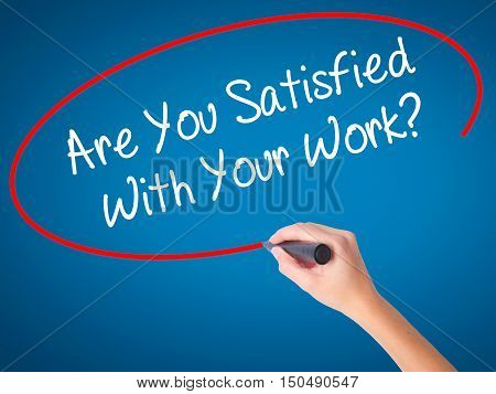 Women Hand Writing Are You Satisfied With Your Work? With Black Marker On Visual Screen