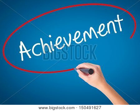 Women Hand Writing Achievement With Black Marker On Visual Screen