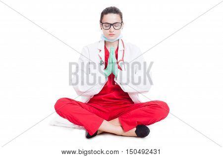 Pretty Medic In Lotus Pose Praying