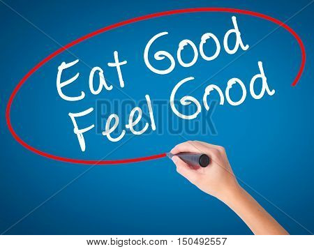 Women Hand Writing Eat Good Feel Good With Black Marker On Visual Screen