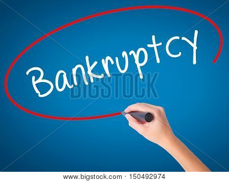 Women Hand Writing Bankruptcy With Black Marker On Visual Screen