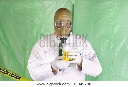 Man In Hazmat Clothing In Decontamination Chamber