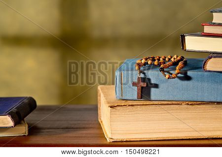 still life with books and rosary in the church