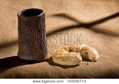 still life with chalice and bread on the textile tablecloth