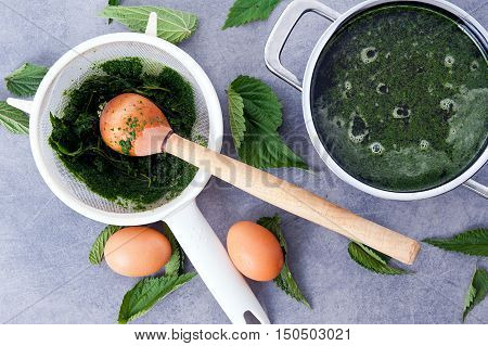 Cooking of vegetarian, healthy stinging nettle soup.