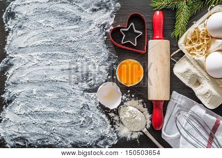 Christmas baking background with utencils and ingredients, copy space