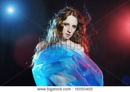 Portrait Of The Young Dancing Woman Against Color Flashes