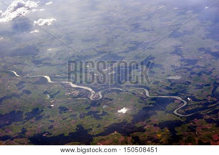 Aerial photograph winding river felds and clouds