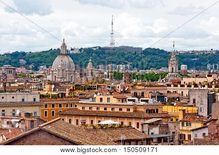 View of dome of basilica in Rome over roofs.