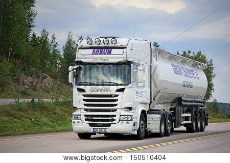 ORIVESI, FINLAND - SEPTEMBER 1, 2016: White Scania R580 semi tank truck of Sorum Transport for bulk transportation on the road in Central Finland.